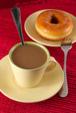 Coffee and donut. With fork and spoon on red table cloth Royalty Free Stock Photography