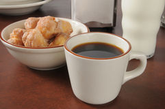 Coffee and donut holes Stock Photo