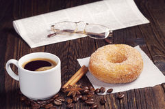 Coffee, donut and newspaper Royalty Free Stock Image