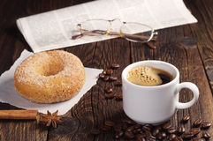 Coffee with donut and newspaper Royalty Free Stock Photography