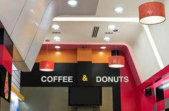 Coffee and donuts. Coffee & donuts Shop decoration with ceiling lights Royalty Free Stock Photo