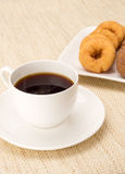 Coffee with donuts Stock Images