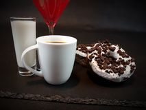 Coffee donuts Oreo doughnuts milk drinking Royalty Free Stock Image