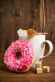 Coffee and donuts in pink icing Royalty Free Stock Photo