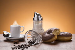 Coffee with donuts on the plate Royalty Free Stock Photo