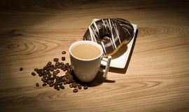 Coffee and donuts with special lighting Royalty Free Stock Photography