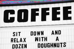 Coffee and doughnut sign Royalty Free Stock Photography