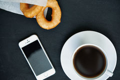 Coffee, doughnuts and smartphone Royalty Free Stock Photos