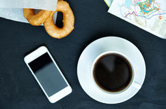 Coffee, doughnuts and smartphone Stock Photos