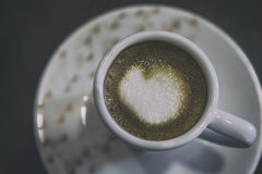 Coffee with a drawn heart Stock Image