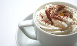 Coffee with dressing. A cup of coffee and  whipped cream with cocoa dust Stock Image