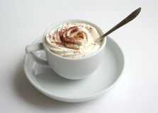 Coffee with dressing 2. A cup of coffee and whipped cream with cocoa dust stock photography