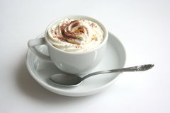 Coffee with dressing 3. A cup of coffee and  whipped cream with cocoa dust Royalty Free Stock Photography