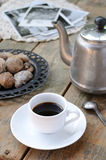 Coffee and dried figs on wooden surface. Cup of black coffee and dried sugared figs on rusted wooden background royalty free stock photos