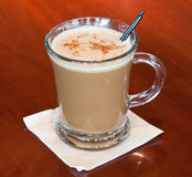 Coffee drink. At a bar garnished with ground nutmeg Royalty Free Stock Image