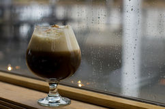 Coffee drink against rainy window Royalty Free Stock Photography
