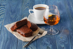 Coffee and drink. Cup of Coffee and Cognac Brandy Whiskey Aperit Royalty Free Stock Image