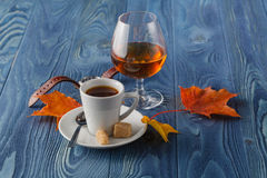 Coffee and drink. Cup of Coffee and Cognac Brandy Whiskey Aperit Royalty Free Stock Images