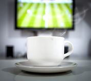 Coffee drink in football live time Royalty Free Stock Image
