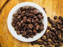 Coffee. Drink. Ingridients. Beans. Wallpaper. Texture. There are coffee beans on wood texture stock photos