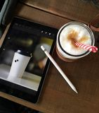 Coffee drink and tablet Stock Image