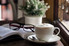 Coffee drink on a wood table. By the window in cafe Stock Image