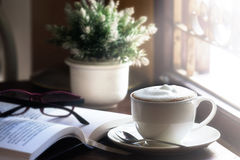 Coffee drink on a wood table. By the window in cafe Stock Photography