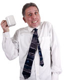 Coffee Drinker Cup of Java Too Much Caffeine. Businessman with the jitters after drinking too much coffee. This man has had way too much caffeine from java! Put stock photo