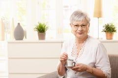 coffee drinking senior woman Стоковое Изображение