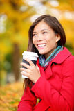 Coffee drinking woman in Autumn fall enjoying fall Royalty Free Stock Image
