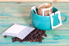 Coffee drip in cup and coffee drip package Royalty Free Stock Photos