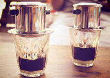 Coffee dripping in vietnamese style, retro filter Royalty Free Stock Photography