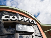 Coffee drive thru sign with cloudy sky Royalty Free Stock Photos
