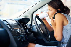 Coffee driving woman Stock Photography