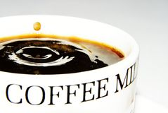Coffee drop. A drop falling into a black coffee Royalty Free Stock Photography