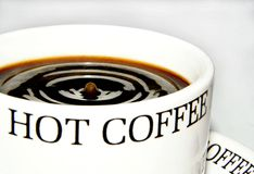 Coffee drop. A drop falling into a black coffee Stock Images