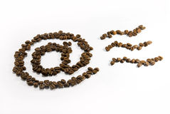 Coffee e-mail. E-mail symbol from coffee beans on white background Stock Images