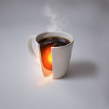Coffee and earth's core. A coffee cup with the heat of the earth's core inside royalty free stock photography