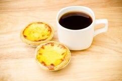 Coffee and egg tart Stock Photos