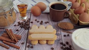 Coffee, eggs, mascarpone cheese and savoiardi cookies for homemade Tiramisu stock footage