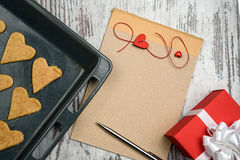 Coffee and empty notepad with red gift box Stock Photo