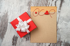 Coffee and empty notepad with red gift box Stock Photos