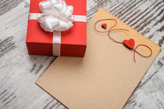 Coffee and empty notepad with red gift box Stock Images
