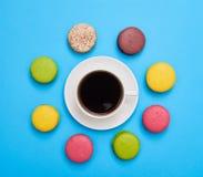 Coffee encircled with a delicious homemade macaro Stock Photos