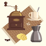 Coffee. Equipment on fabric.  mill, , sugar, croissant, cup of  with spoon Royalty Free Stock Photography
