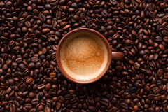 Coffee espresso with beans. Coffee espresso cup on beans background. Top view Royalty Free Stock Images