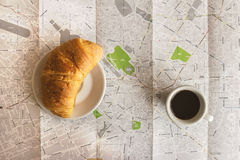 Coffee espresso and brioche croissant on the Milan map Stock Image