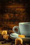 Coffee espresso with cane sugar and coffee beans Stock Images