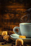 Coffee espresso with cane sugar and coffee beans Royalty Free Stock Photography
