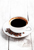 Coffee Espresso. Coffee cup with roasted coffee beans over white Royalty Free Stock Photography